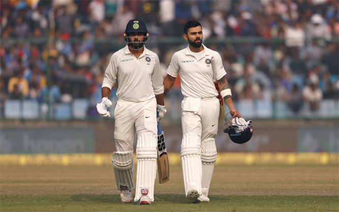 Kohli (156*) and Vijay (155) put on a 283-run third-wicket stand