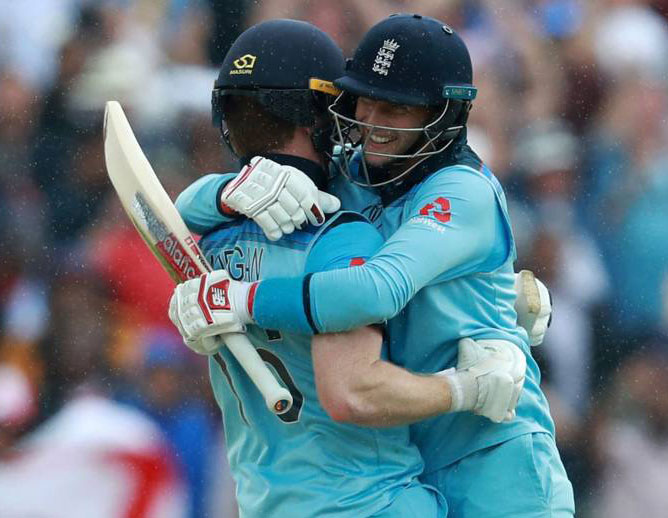 Root and Morgan celebrates England win.