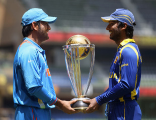 Indian MS Dhoni and Sri Lanka Kumar Sangakkara pose with the World Cup on the eve of the final in Mumbai.